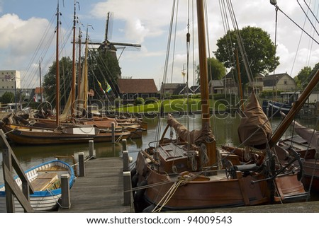 Windmill and Fishing boats at Harderwijk - stock photo