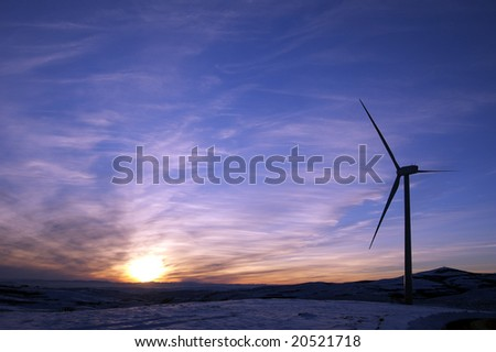 Windmill and sunset - stock photo