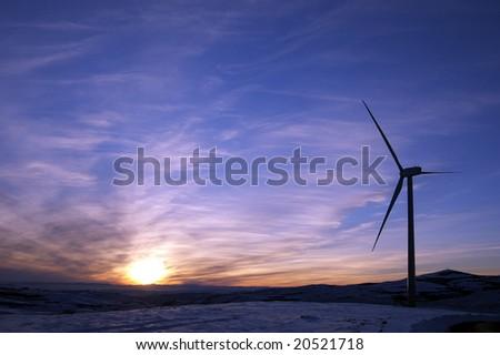 Windmill and sunset - stock photo