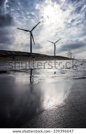 windmill beside beach - stock photo