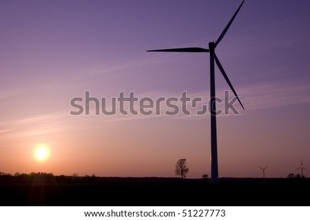 Windmill conceptual image. Windmill in sundown. - stock photo