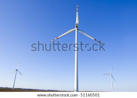Windmill conceptual image. Windmills against the blue sky. - stock photo