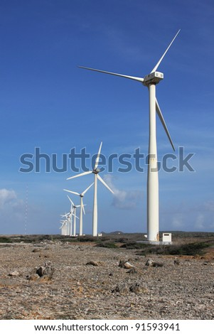 Windmill farm Wind farm or Wind turbines to harvest wind energy. Located on the Hato plains on Curacao - stock photo