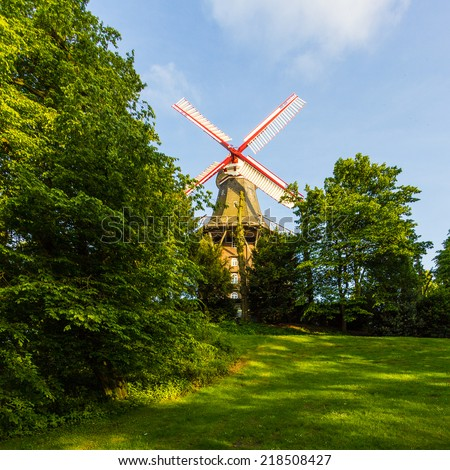 Windmill in park - stock photo