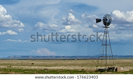 Windmill in the Desert Southwest - stock photo