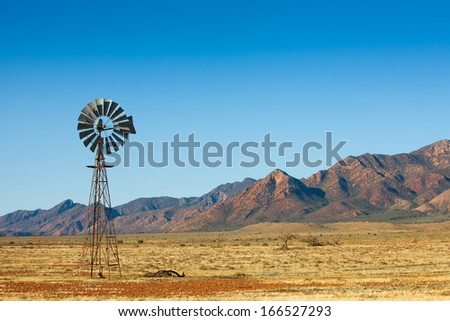 Windmill in the Flinders Ranges, South Australia - stock photo