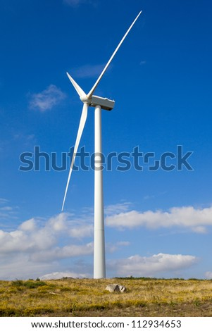 Windmill in the top of a mountain against beautiful sky - stock photo