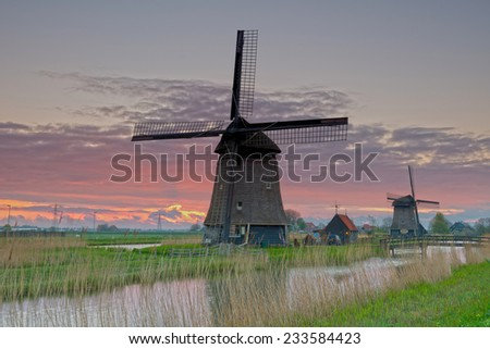 Windmill near Rustenburgat sunrise, Netherlands - stock photo