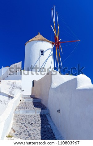 Windmill of Oia village on Santorini island, Greece - stock photo