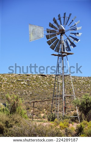 Windmill on an agricultural farm in the Northern Cape of South Africa - stock photo