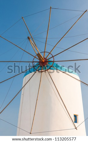 Windmill on Greek island in the Aegean Sea - stock photo