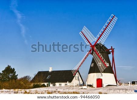 Windmill on Mando in the wadden sea, Ribe, Denmark - stock photo