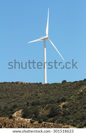 Windmill on mountain, Paphos district, Cyprus - stock photo