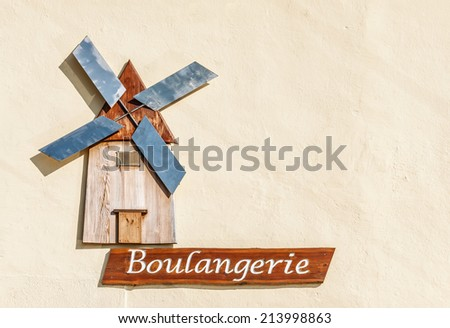 Windmill on Sign for a Boulangerie or Bakery - stock photo