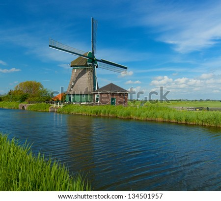 Windmill on the outskirts of Amsterdam. Holland the Netherlands. Panorama - stock photo