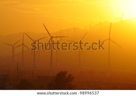 Windmill park near Palm Springs during sunset - stock photo