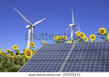 Windmill,Solar Panel And Sunflower - stock photo