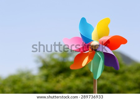 windmill spinning in wind on blue sky - stock photo