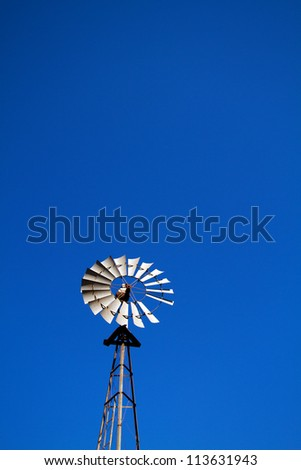 Windmill with blue sky plenty of room for text - stock photo