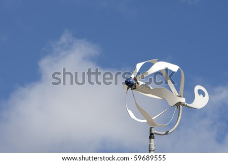 Windmill with clouds - stock photo