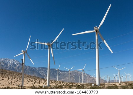 Windmills against a blue sky - stock photo