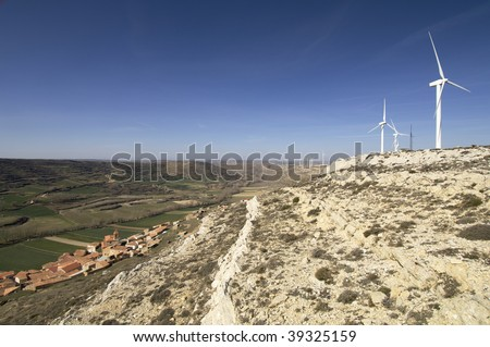 windmills and small village in Spain - stock photo