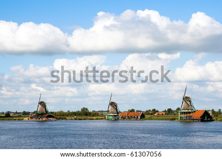 Windmills at the famous Zaanse Schans in Holland - stock photo