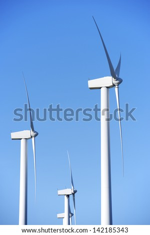 windmills for  electric power production and blue sky, El Buste, Zaragoza, Aragon, Spain - stock photo
