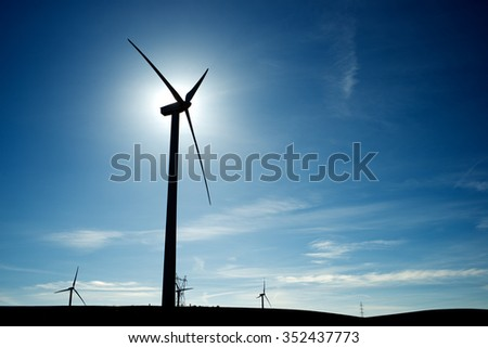 Windmills for electric power production at sunset, Zaragoza Province, Aragon, Spain - stock photo