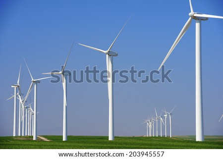 Windmills for electric power production, Pozuelo de Aragon, Zaragoza, Aragon, Spain - stock photo