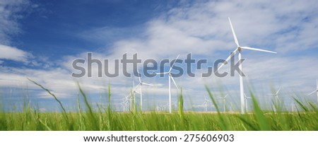 Windmills for electric power production, Zaragoza province, Aragon, Spain. - stock photo
