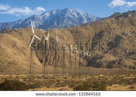 Windmills in Mountain Valley - stock photo