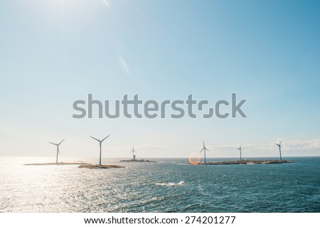Windmills in the Baltic sea - stock photo