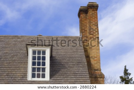 Window and chimney in Colonial Williamsburg - stock photo