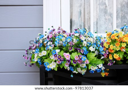 Window and flower box - stock photo