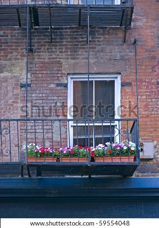 window and metal fire escape of old building in Manhattan, New York, America, USA - stock photo
