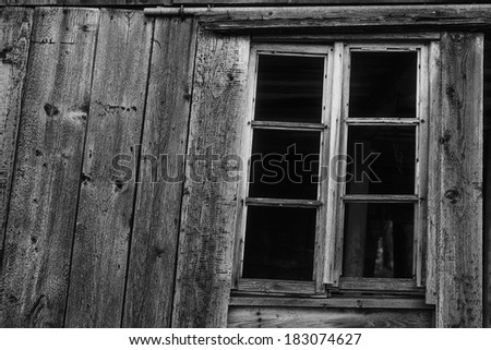 window broken wooden shed in black and white - stock photo