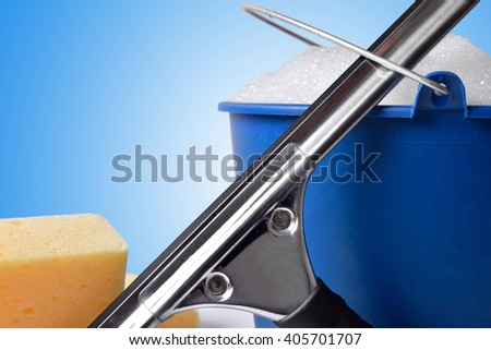 Window cleaning tools on white table, close up. Front view. Horizontal composition - stock photo