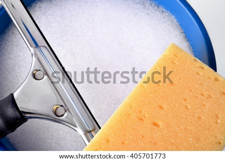 Window cleaning tools on white table, close up. Top view. Horizontal composition - stock photo