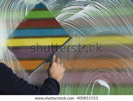 window cleaning with a squeegee - stock photo
