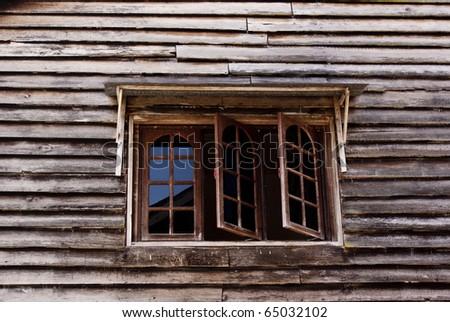 Window frame in wooden cabin - stock photo