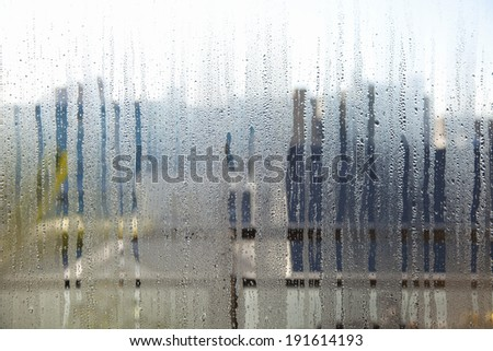 Window glass with condensation - stock photo