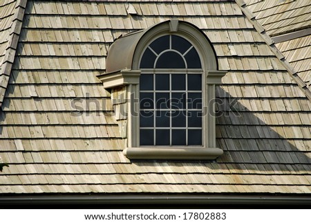 Window in an attic - stock photo