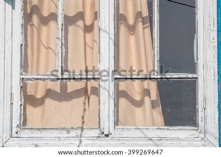 Window in an old wooden house dacha - stock photo