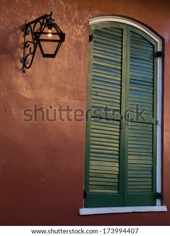 Window in French Quarter of New Orleans at twilight. - stock photo