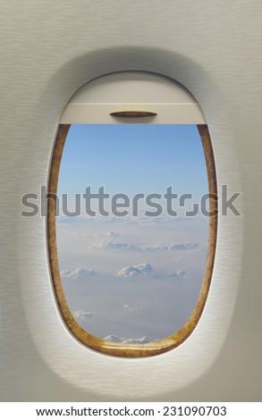 window in modern jet airplane - stock photo