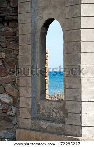 window in the ruins - stock photo