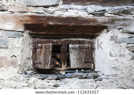 Window of a old cottage in the Alps mountains - stock photo