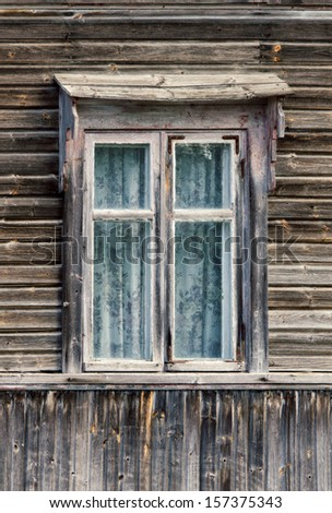 Window of an old wooden cottage - stock photo