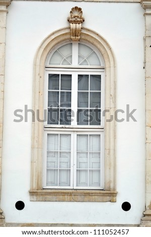 Window of old buildings at the University of Coimbra - stock photo